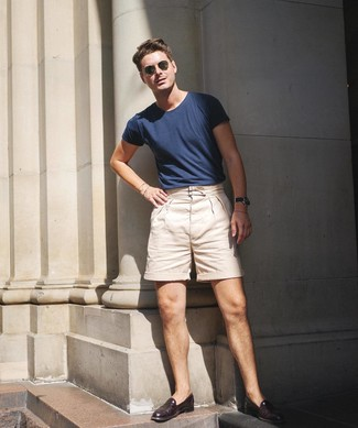 How to Wear Burgundy Leather Loafers For Men: This combo of a navy crew-neck t-shirt and beige shorts is very easy to put together and so comfortable to rock throughout the day as well! Burgundy leather loafers are guaranteed to bring a hint of sophistication to this look.