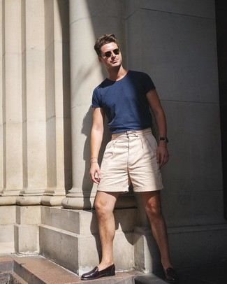 How to wear: navy crew-neck t-shirt, beige shorts, dark brown leather loafers, olive sunglasses