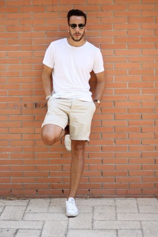How to wear: white crew-neck t-shirt, beige shorts, white canvas low top sneakers, black sunglasses