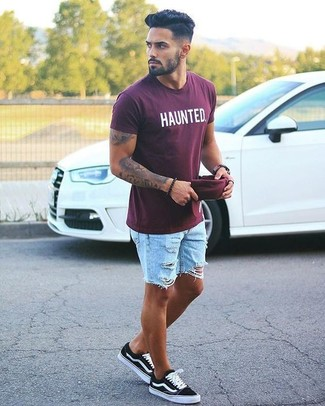 How to wear: burgundy print crew-neck t-shirt, light blue ripped denim shorts, black low top sneakers, burgundy baseball cap