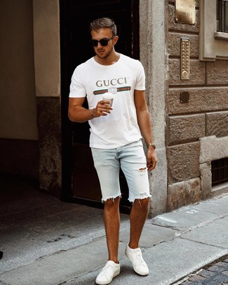 How to wear: white print crew-neck t-shirt, light blue ripped denim shorts, white leather low top sneakers, black sunglasses