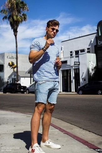 How To Wear Light Blue Denim Shorts With White Sneakers In Your 20s For Men: A white and blue horizontal striped crew-neck t-shirt and light blue denim shorts worn together are a match made in heaven for men who prefer casual combinations. And if you wish to immediately play down this outfit with a pair of shoes, introduce white sneakers to your ensemble.