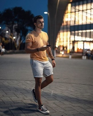 How to Wear a Mustard Crew-neck T-shirt For Men: A nicely pulled together pairing of a mustard crew-neck t-shirt and grey shorts will set you apart instantly. Black print canvas low top sneakers serve as the glue that pulls this ensemble together.