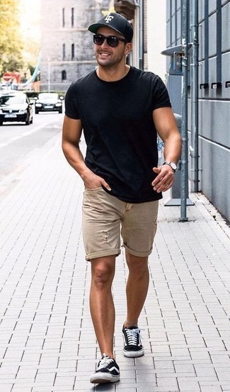 How to Wear Denim Shorts For Men: Display your credentials in men's fashion by wearing this street style pairing of a navy crew-neck t-shirt and denim shorts. Complete your look with a pair of black and white canvas low top sneakers and ta-da: the outfit is complete.