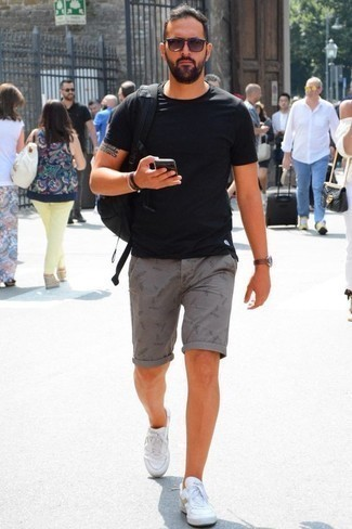 How to Wear a Black Bracelet For Men: You'll be amazed at how super easy it is for any gentleman to get dressed like this. Just a black crew-neck t-shirt worn with a black bracelet. A pair of white canvas low top sneakers instantly turns up the fashion factor of this getup.