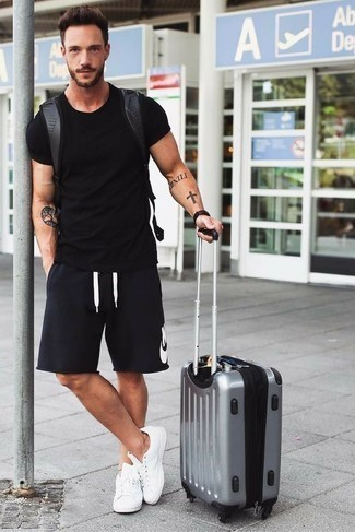 Men's Looks & Outfits: What To Wear In 2020: A black crew-neck t-shirt and black and white print shorts are amazing menswear staples to have in your current off-duty repertoire. The whole look comes together perfectly if you add white canvas low top sneakers to the mix.