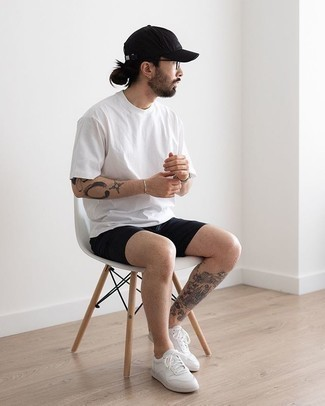 Black Shorts Outfits For Men: Why not consider pairing a white crew-neck t-shirt with black shorts? Both of these pieces are totally comfortable and look good together. Let your sartorial savvy truly shine by completing this look with a pair of white canvas low top sneakers.
