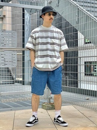 Blue Denim Shorts Outfits For Men: A white horizontal striped crew-neck t-shirt and blue denim shorts make for the ultimate laid-back ensemble for today's guy. A pair of black and white canvas low top sneakers integrates smoothly within a multitude of ensembles.