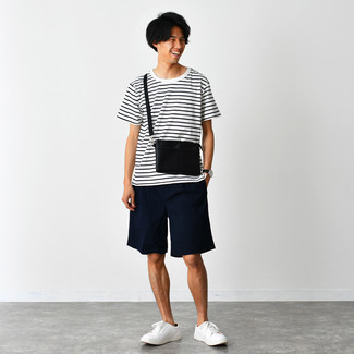 White Leather Low Top Sneakers Outfits For Men: This relaxed combination of a white and black horizontal striped crew-neck t-shirt and navy shorts can only be described as devastatingly dapper. A great pair of white leather low top sneakers ties this getup together.