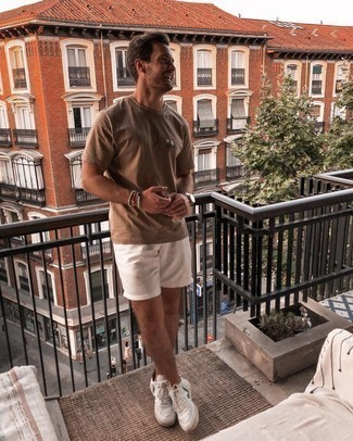 White Shorts Casual Outfits For Men: Teaming a brown crew-neck t-shirt with white shorts is an awesome option for an off-duty outfit. A pair of white and green leather low top sneakers can integrate seamlessly within a multitude of combos.