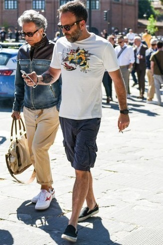 How to Wear a White Print Crew-neck T-shirt For Men: Consider pairing a white print crew-neck t-shirt with navy shorts for a lazy-day outfit. Amp up the formality of this look a bit with black canvas slip-on sneakers.