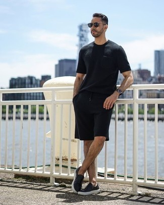 How to Wear Black Shorts For Men: Opt for a black crew-neck t-shirt and black shorts to put together an interesting and modern-looking off-duty outfit. When it comes to shoes, go for something on the more elegant end of the spectrum by finishing with black leather slip-on sneakers.