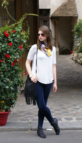 Make a white crew-neck t-shirt and a Betsey Johnson women's Fringe Party Crossbody your outfit choice, if you feel like comfort dressing without looking like you don't care. A cool pair of black leather ankle boots is an easy way to upgrade your look. This look is everything for those warmer springtime days.