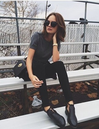 How to wear: charcoal crew-neck t-shirt, black skinny jeans, black cutout leather ankle boots, black leather crossbody bag