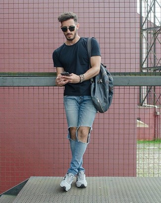 How to wear: black crew-neck t-shirt, light blue ripped skinny jeans, grey athletic shoes, navy canvas backpack