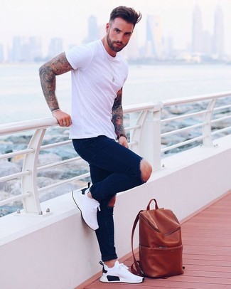 Consider wearing a white crew-neck t-shirt and navy ripped skinny jeans, if you want to dress for comfort without looking like you don't care. Balance this getup with white athletic shoes. Clearly, you're looking at a good choice for a warm hot weather day.