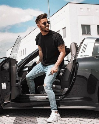 How to Wear Light Blue Ripped Skinny Jeans For Men: Why not pair a black crew-neck t-shirt with light blue ripped skinny jeans? As well as very comfortable, both pieces look cool when worn together. Introduce white athletic shoes to your outfit and ta-da: the getup is complete.