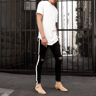 500+ Relaxed Outfits For Men: Make a white crew-neck t-shirt and black ripped skinny jeans your outfit choice for equally stylish and easy-to-wear look. A pair of beige suede chelsea boots effortlessly classes up the outfit.