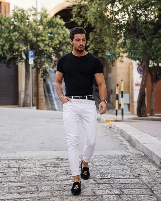 1200+ Hot Weather Outfits For Men: This edgy pairing of a black crew-neck t-shirt and white skinny jeans can be taken in different directions depending on the way you style it. A pair of black embroidered velvet loafers effortlessly amps up the wow factor of this outfit.