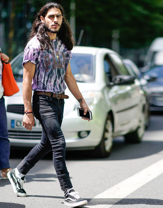 How to Wear a Brown Woven Leather Belt For Men: A light violet tie-dye crew-neck t-shirt and a brown woven leather belt are indispensable staples if you're putting together a casual closet that matches up to the highest style standards. For a dressier twist, why not introduce black and white canvas low top sneakers to your ensemble?