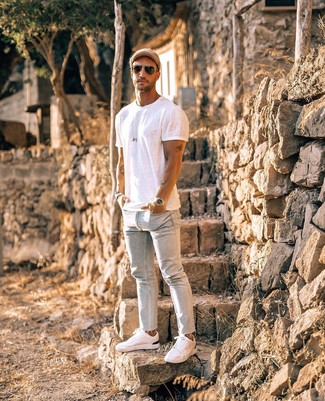 How to wear: white crew-neck t-shirt, light blue skinny jeans, white low top sneakers, tan baseball cap