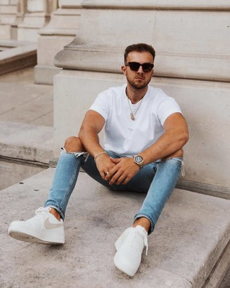How to wear: white crew-neck t-shirt, blue ripped skinny jeans, white leather low top sneakers, black sunglasses