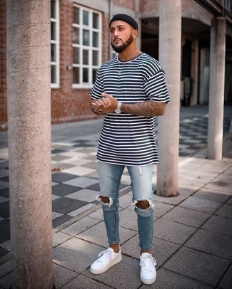 How to Wear Light Blue Ripped Skinny Jeans For Men: This casual combination of a white and navy horizontal striped crew-neck t-shirt and light blue ripped skinny jeans takes on different moods according to the way you style it out. Introduce white canvas low top sneakers to this getup to immediately dial up the fashion factor of your ensemble.