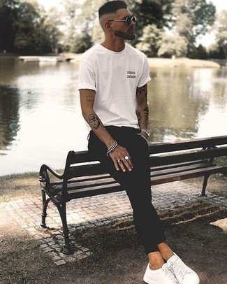 Men's Looks & Outfits: What To Wear In Hot Weather: This pairing of a white and black print crew-neck t-shirt and black skinny jeans makes for the ultimate off-duty look for today's gent. Why not introduce a pair of white canvas low top sneakers to the mix for an extra touch of sophistication?