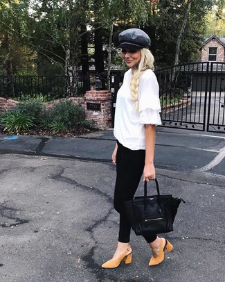 How to Wear Tan Suede Pumps: Why not marry a white ruffle crew-neck t-shirt with black skinny jeans? Both of these pieces are totally comfortable and look incredible combined together. Ramp up the cool of your getup by wearing a pair of tan suede pumps.