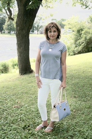 How to wear: grey horizontal striped crew-neck t-shirt, white skinny jeans, silver thong sandals, light blue leather tote bag