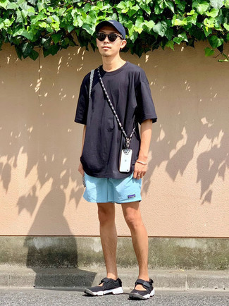 Navy Crew-neck T-shirt Outfits For Men: A navy crew-neck t-shirt and light blue sports shorts are essential in any modern gent's versatile off-duty wardrobe. A pair of black and white athletic shoes is a savvy pick to finish this outfit.