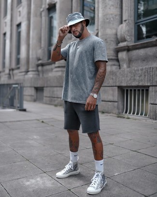 Bucket Hat Outfits For Men: This casual street style combination of a grey tie-dye crew-neck t-shirt and a bucket hat is very easy to pull together without a second thought, helping you look sharp and ready for anything without spending too much time going through your closet. Grey print canvas high top sneakers are a simple way to bring a dose of polish to this ensemble.