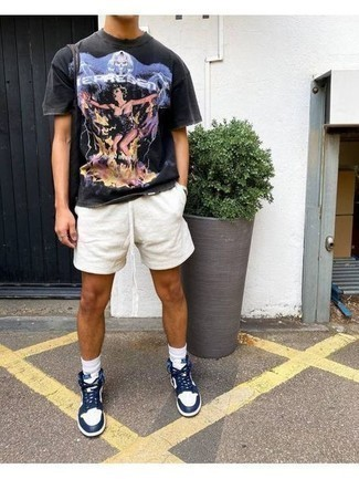 Socks Outfits For Men: If you're in search of a laid-back but also seriously stylish ensemble, reach for a black print crew-neck t-shirt and socks. Our favorite of an endless number of ways to complement this look is white and navy leather high top sneakers.