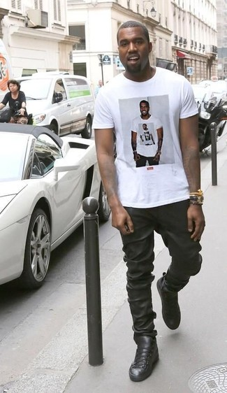 Kanye West wearing White Print Crew-neck T-shirt, Black Leather Sweatpants, Black Leather High Top Sneakers, Black Leather Watch