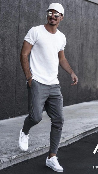 How to wear: white crew-neck t-shirt, grey sweatpants, white canvas low top sneakers, black baseball cap
