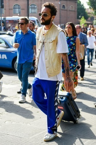 Blue Suitcase Outfits For Men: This relaxed combo of a white print crew-neck t-shirt and a blue suitcase is perfect when you need to look good in a flash. On the fence about how to complement this ensemble? Rock white low top sneakers to ramp it up.