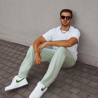 Mint Sweatpants Outfits For Men: Opt for a white crew-neck t-shirt and mint sweatpants to achieve an incredibly dapper and edgy ensemble. For a more polished touch, why not complement your look with a pair of white and green canvas low top sneakers?