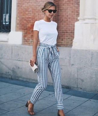 How to wear: white crew-neck t-shirt, white and blue vertical striped tapered pants, brown leather heeled sandals, grey leather clutch