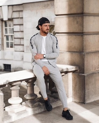 Track Suit Outfits For Men: Such essentials as a track suit and a white crew-neck t-shirt are an easy way to introduce some cool into your daily casual repertoire. Complete this outfit with black athletic shoes and off you go looking dashing.