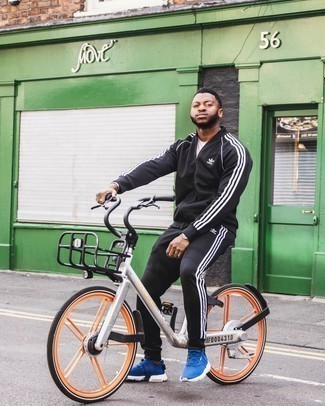 Black Track Suit Outfits For Men: The ultimate choice for relaxed menswear style? A black track suit with a white crew-neck t-shirt. Introduce blue athletic shoes to this ensemble and the whole ensemble will come together.
