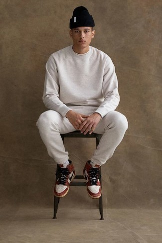 How to Wear a Track Suit For Men: A track suit and a white crew-neck t-shirt make for the ultimate relaxed casual outfit for today's guy. Introduce a pair of white and red leather high top sneakers to the mix and ta-da: your look is complete.