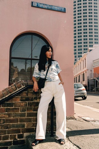 How to Wear White Denim Wide Leg Pants: Flex your styling chops by putting together a light blue acid wash crew-neck t-shirt and white denim wide leg pants for a casual combination. Add a pair of black leather flat sandals to the equation to avoid looking overdressed.