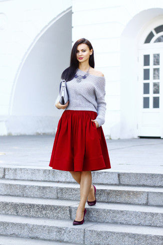 Step up your off-duty look in a grey cropped sweater and a red full skirt. For footwear go down the classic route with oxblood suede pumps.