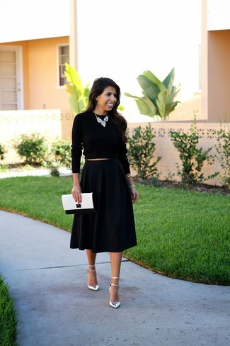 Go for a black cropped sweater and a black full skirt for both chic and easy-to-wear look. Make metallic leather pumps your footwear choice to instantly up the chic factor of any outfit.