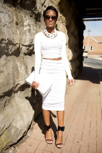 How to Wear a White Pencil Skirt: Pairing a white cropped sweater with a white pencil skirt is a good pick for a casually edgy look. And if you want to effortlesslly up your look with one item, introduce a pair of black leather heeled sandals to the mix.