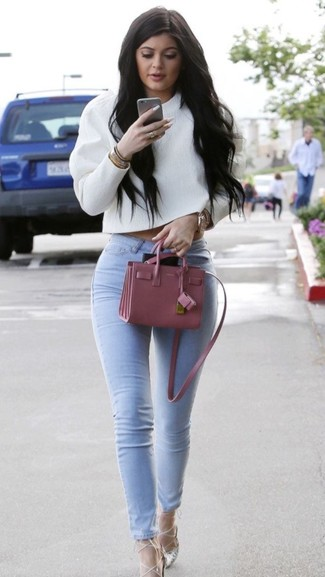 A white cropped sweater and light blue skinny jeans will give off this very sexy and chic vibe. Add silver leather pumps to your look for an instant style upgrade.