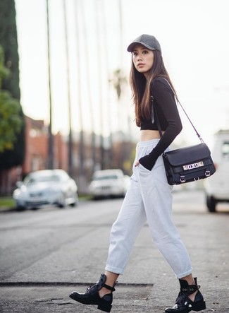 Pair a black cropped sweater with white running pants for an unexpectedly cool ensemble. Dress up this look with black cutout leather ankle boots. Rest assured, this ensemble is the answer to all of your spring dressing woes.