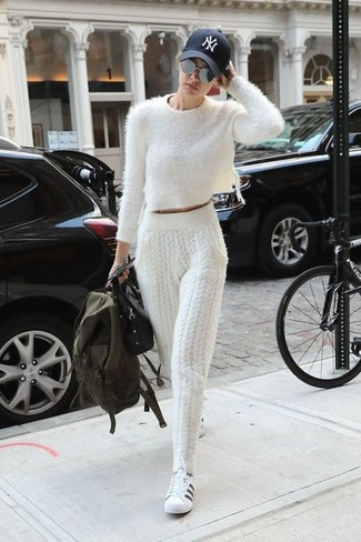 How to wear: white fluffy cropped sweater, white knit sweatpants, white and black leather low top sneakers, black leather satchel bag
