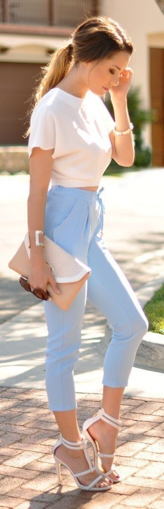 How to wear: white cropped top, light blue capri pants, white leather heeled sandals, beige leather clutch