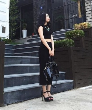 This combination of a black cropped top and black culottes epitomizes comfort and effortless style. And it's a wonder what a pair of black suede heeled sandals can do for the look. What better pick for a extremely hot afternoon?